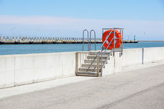 Dock at the port with security equipment Stock Photography