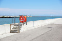 Dock at the port with security equipment Royalty Free Stock Photo
