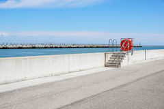 Dock at the port with security equipment Stock Photo