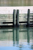 Dock Reflection. In the water of the Bay of Fundy - Nova Scotia Royalty Free Stock Photo