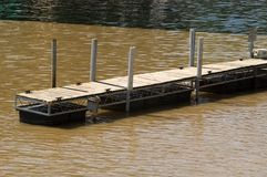 Dock in the River. An empty dock on the Rocky River in Cleveland, Ohio Royalty Free Stock Photo