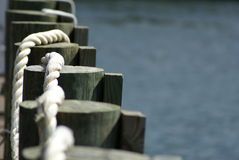 Dock and rope. A dock with new rope Royalty Free Stock Photo