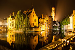 The dock of the Rosary, Rozenhoedkaai, with Belfry Tower by night, Bruges, Belgium Stock Image
