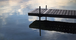 Dock and Shadow on a Lake Royalty Free Stock Photos