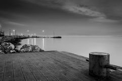 Dock And Shoreline In The Night Royalty Free Stock Photo