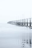 Dock shrouded by the fog Stock Photos