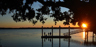 Dock silhouette at sunset Royalty Free Stock Photos