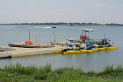 Dock at Standley Lake in Westminster Colorado. With pedal boats, park ranger boat and flotation device royalty free stock photography