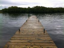 Dock on still water. Northern Ireland, Loch Stock Photos