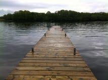 Dock on still water Stock Photos
