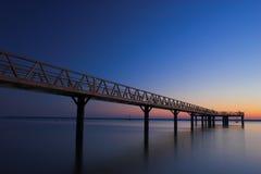 Dock at sunset. Colorful sunset landscape stock image
