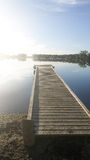 Dock at sunset. Dock on a lake Royalty Free Stock Images