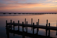 Dock at sunset. Sunset over Chincoteague Bay Virginia, with dock in foreground stock photos