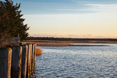 Dock at sunset in Sag Harbor New York. A dock at sunset looking over Gardiner`s Bay in Sag Harbor New York Royalty Free Stock Image