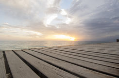 Dock at sunset. Wooden dock at sunset in Cozumel, Mexico royalty free stock photos