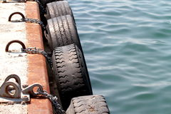 Dock tire bumpers. To ships and boats Stock Photography