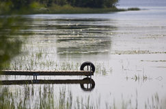Dock and Tire Reflecting Royalty Free Stock Photo
