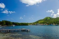 Dock and Tropical Island Stock Photos