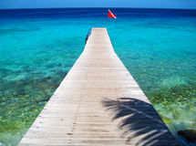 Dock and Tropical Ocean, Curacao. Boat Dock with Scuba Dive Flag and Blue Tropical Ocean, Curacao stock images