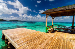 Dock in Turquoise Water. Wooden dock in beautiful blue and turquoise water in San Andres y Providencia, Colombia Royalty Free Stock Photos