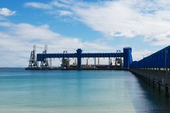 Dock unloading a ship Royalty Free Stock Images