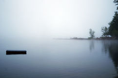 Dock Vanishes Into The Fog Stock Images