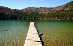 Dock on the volcanic lake Stock Photography