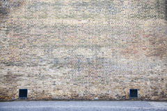 A dock wall. A brick wall in London with drains Royalty Free Stock Photography
