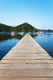Dock in the water. A wooden dock in the water Royalty Free Stock Images