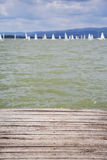 Dock with water surface. Closeup of the wooden dock with water surface Stock Photography