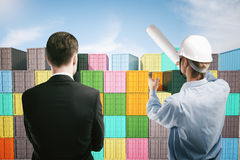 Dock worker and businessman discussing Royalty Free Stock Image
