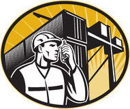 Dock Worker Talking Phone Container Crane. Illustration of a dock worker talking on the phone with container van and crane overhead done in retro style Royalty Free Stock Images