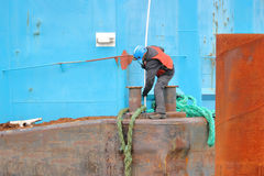 Dock Worker Tying Up Barge Royalty Free Stock Photos
