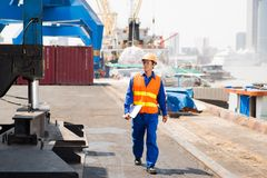 Dock worker. Walking around cargo port Stock Photos