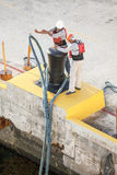 Dock Workers Cast Off Ship Mooring Ropes Royalty Free Stock Photos