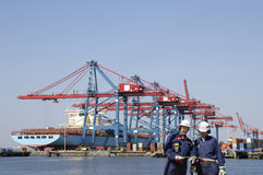Dock workers and container port Stock Photos