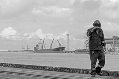 Dock workers finishing their work Royalty Free Stock Image