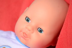Docka med blåa ögon Arkivbild