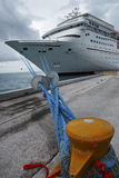 Docked. Vertical image of the bow of cruise ship in port- wide angle emphasizing docking ropes Stock Photo