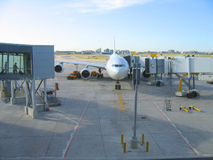 Docked Airplane. At the airport Stock Images