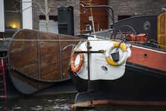 A docked backside of a ship with lifebouys attached to the backs. Ide in the harbor of Leiden royalty free stock images