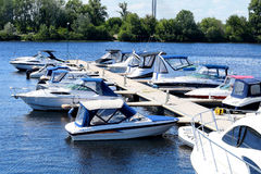 Docked boat. Boat mooring in the river port. View of the boat and the river Stock Images