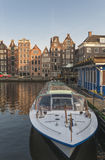 Docked boat on canal in Amsterdam Stock Photos