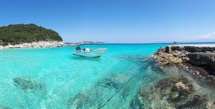 Docked boat. On the coast of Antipaxos stock photos