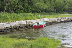 Docked Boat. This boat is docked using a stone wall Royalty Free Stock Photo