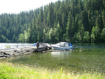 Docked boats. Deep into the wilderness are beautiful lakes to explore Royalty Free Stock Images