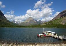 Docked Boats. Boats docked on beautiful mountain lake royalty free stock images