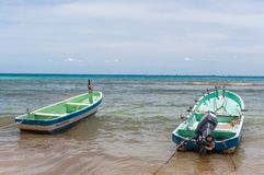 Docked Boats in a Beach Scene at Playa del Carmen Royalty Free Stock Photography