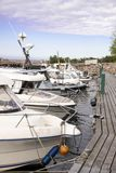 Docked boats. moored boats. Boats standing in a row at a wooden pier. Docked boats royalty free stock photos