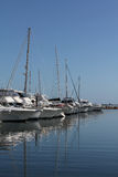 Docked Boats and yachts. Row of docked boats and yachts stock photo